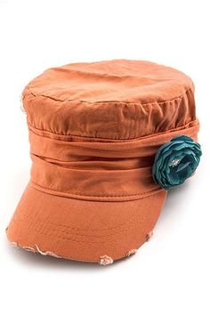 Orange military hat with turquoise rosette