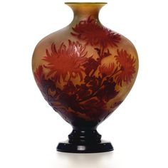A Gallé cameo glass vase circa 1910 colourless glass with an opalescent yellow layer, overlaid in shades of red and etched and carved with chrysanthemums cameo mark Gallé height 33 cm