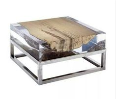 Acrylic table top with stainless steel legs