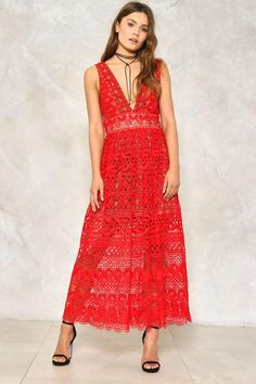 This isn't your grandma's crochet. The Isobel Dress features a plunging neckline, crochet overlay, sheer hem, zip closure at back, and partial nude lining. Pair it with a bold red lip.