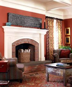 Red-hued walls in Benjamin Moore's Baked Clay accent this hearth's brick surround and warm up the family room. | Photo: Laura Moss | thisoldhouse.com