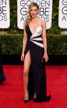 Katie Cassidy shows a whole lotta skin for the 2015 Golden Globes!