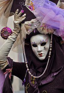 Cream and purple costumed masquerader - fantastic hat