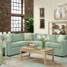 Howard Miller Lenny Two Piece Sectional Sofa 2 in Seafoam Features: -Sectional sofa. -Seafoam fabric. -1.8 Density high resilient seat cushion with dacron wrap construction. -Frame construction: Hardwood. -Earth brown legs. -Sinuous spring. -Welt on...