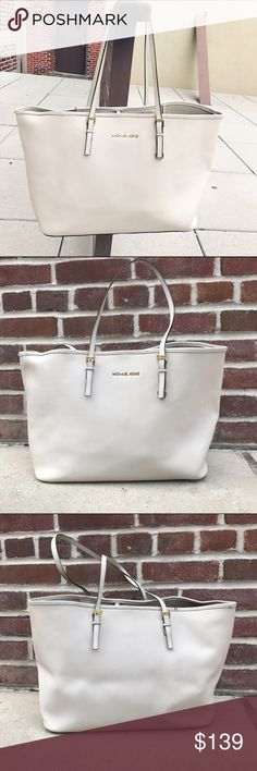 MICHAEL KORS Jet Set Large Tote Michael Kors Jet Set Large Tote -Saffiano Leather. -Color: Off-white -Inside is clean but has some marks, comes from non-smoking home. -In great condition. Has one small rip as pictured, and shape has been lost a bit due to storage.   *Additional pictures upon request.   NO Trades. Please make all offers through offer button. Michael Kors Bags Totes