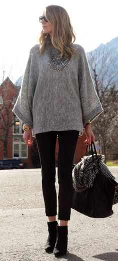 Street fashion oversize sweater and statement necklace