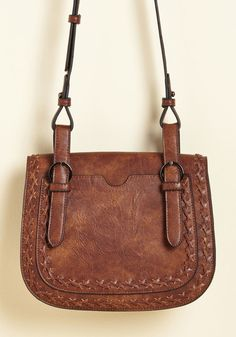 <p>Take this brown purse along for the morning commute, or have it accompany you to a late-night flick with your friends - its faux-leather fabric punctuated with crisscross stitching, handy front pouch, and intersecting shoulder straps make it a viable candidate for wherever the agenda takes you!</p>