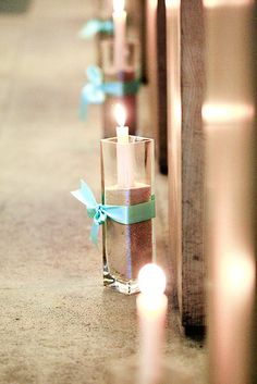 candles in sand, how easy is that! and inexpensive! maybe for the tables?