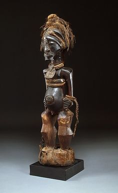 Power Figure: Male (Nkisi) Date: 19th–20th century Geography: Democratic Republic of the Congo Culture: Songye peoples Medium: Wood, copper, brass, iron, fiber, snakeskin, leather, fur, feathers, mud, resin Dimensions: H. 39 in. (91.9 cm)