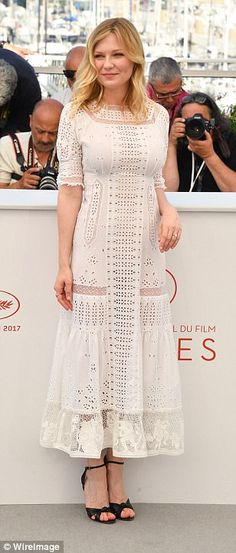 Sensational: Also sticking to the white colour scheme was stunning Kirsten Dunst - who commanded attention in a figure-flattering white laser cut dress