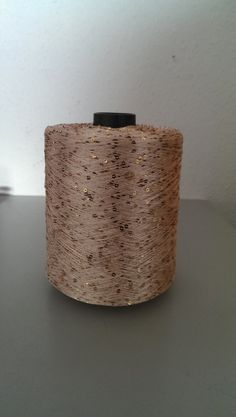 1 spool 1 kg sequin yarn  Nm 5,2 apricot/gold 5.200 m/kg on cone