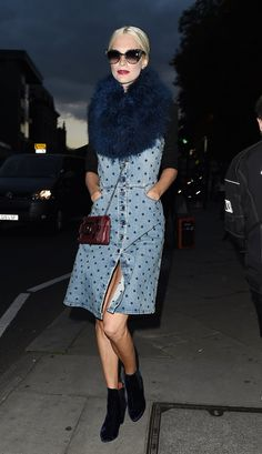 Pin for Later: The Stars Are Looking Quite Stylish Over in Milan Poppy Delevingne The printed denim dress Poppy wore to House of Holland became even more statement making with the addition of a furry stole.