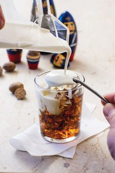 White Russian: The drink is simple to make and best served layered. Pour the cream over the back of a spoon to keep it floating on the top. The drinker may choose to stir it all together if desired. While this recipe uses the ratio of 2:1:1, some prefer this drink with a 1:1:1 ratio instead, that is vodka : coffee liqueur : cream. As a garnish, try grating a little fresh nutmeg over the top.