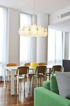 I've always wanted to use this light fixture in a project and finally got my way.  I love the mix of styles with the Prouvé chairs and then this grand light fixture from Marcel Wanders for Flos