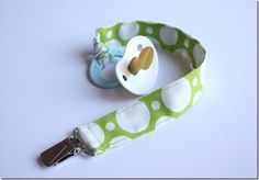 Great pacifier clip tutorial. I made these! And although it was my first sewing project (and I still can't sew a straight line...) they still turned out really cute :) Ironing the fabric is key!