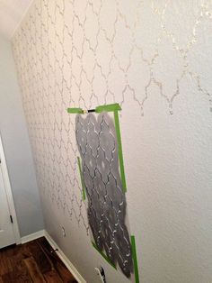 A Marrakech trellis stenciled accent wall in a girl's bedroom from Cutting Edge Stencils