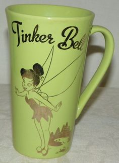 "Disney Tinkerbell Coffee Tea Cup Mug. Character: Tinkerbell. Size of Mug: 5 7/8"" tall X 4.75"" wide including handle. Colors: Green and Silver ~ Metallic. 