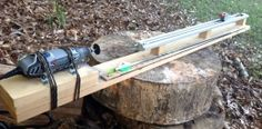 Arrow Saw - Homemade arrow saw constructed from a rotary tool, lumber, L brackets, and a sliding clamp.