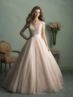 Allure Bridals: Style: M524 This regal gown features a ballgown skirt and intricate beading throughout the bodice.