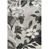 "Found it at Wayfair - Platinum Antiqued Silver Flowers Area Rug $438 7'10"" x 10'6"" - could match family room as well"