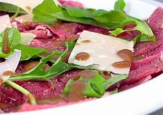 Carpaccio (Italian version of steak tartare) Carpaccio is an Italian recipe for a raw beef appetizer traditionally dressed with a lemony mayonnaise. This recipe uses balsamic vinaigrette instead. Beef Appetizers, Appetizer Recipes, Ny Steak, Carpaccio Recipe, Light Summer Meals, Steak Tartare, Beef Dishes, Steak Recipes, Italian Recipes