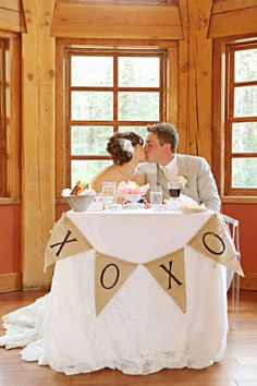Bride and groom have their own table... cute idea.