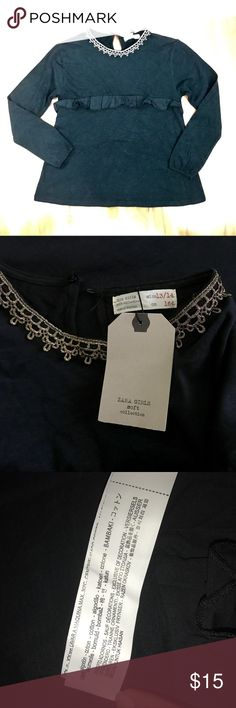 Zara kids girls black long sleeve nwt gold collar Cute, stylish top for girls. Size 13/14. It's long sleeve with elastic sleeves. It features a ruffled trim running down the middle of the shirt, and a beautiful metallic gold patterned trim along the collar/neckline. Super stylish but super comfortable as well. Brand new with tag. Zara Shirts & Tops Tees - Long Sleeve