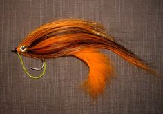 This Zonker wig hair streamer has an Orange arctic fox zonker tied at the back of the hook Bunny bug stylie. Then clumps of Orange and black...