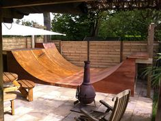 Garden halfpipe for skate board add dry slop carpet and becomes garden ski slope
