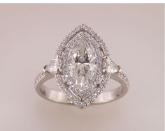Marquise cut diamond with double diamond halo.