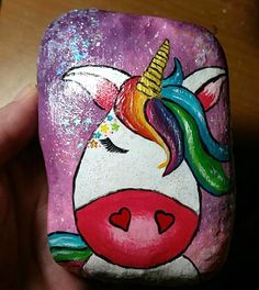 rock painting ideas - magic unicorn with rainbow mane stars and sparkles