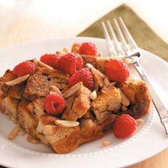 Raspberry-Cinnamon French Toast Recipe -This moist French toast bake is a snap to assemble the night before and bake in the morning. While it's pleasantly sweet as is, let guests drizzle raspberry syrup over the top for a finishing touch. —Taste of Home Test Kitchen