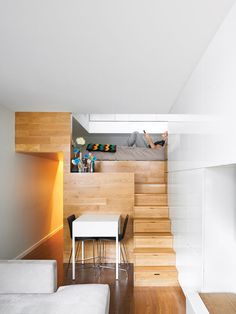 Not a square inch of storage is lost in Michael Pozner's not-quite-500-square-foot aerie in Greenwich Village. Of the seven steps leading up to the sleeping area, five contain drawers. Photo by Raimund Koch. Photo by Raimund Koch. This originally appeared in The Manhattan Transformation.