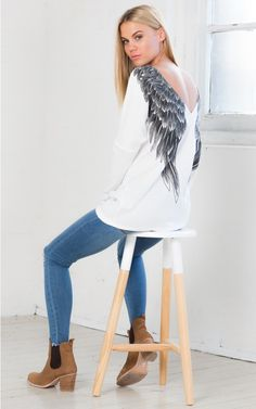 Guardian Angel knit in white | SHOWPO Fashion Online Shopping  $45 This graphic printed knit will keep you warm and comfy this winter. The angel wings add an extra element to your look and is the perfect accesory to whatever you're wearing! #iloveshowpo