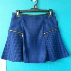 """*HP 01/25*Stoosh Flare Mini Skirt Faux leather trim on waistline and two decorative zippers in front gives this skirt cuteness overload;)  Black and cobalt blue color. Measurements:- waist-14.5""""; length- 15.5"""". Materials: shell-98%polyester, 2%spandex; contrast- 100%polyurethane stoosh Skirts Mini"""