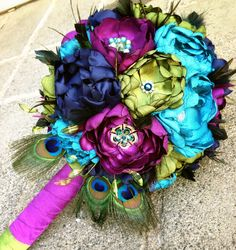 (Handmade Beautiful Peacock Fabric Flowers) Love silk fabric handmade flowers with gem and rhinestone centers and accents...just Beautiful. ...everlasting.  -KML