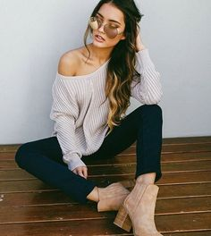 Black jeans and off the shoulder sweater