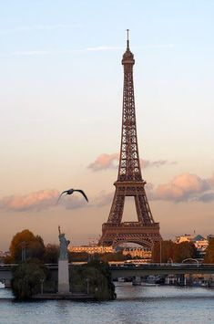 Eiffel Tower with mini Statute of Liberty                                                                                                                                                                                 More