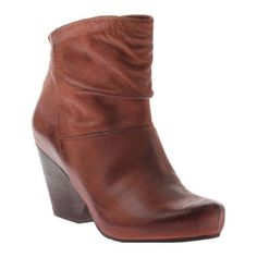 37558103989 The Branford is a sleek and modern boot featuring a zipper with a tassel  pull