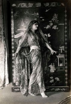 Dancing, Oriental. The British Indian dancer Princess Nadja in transparent sari, with her Oriental dance is extraordinary impression in the salons of Paris, France 1924.