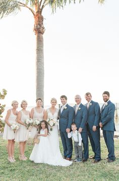 Outdoor, Bridal Party Wedding Portrait with Bridesmaids and Groomsmen | Bridesmaids in Neutral Tea Length Wedding Dresses and Groomsmen in Navy Blue Suits