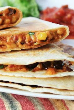 Stuffed Corn & Black Bean Quesadillas - you'd never believe how simple these restaurant-quality quesadillas are to put together! Perfect appetizer for New Year's