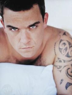 robbie williams. his stare is soooo whoa!