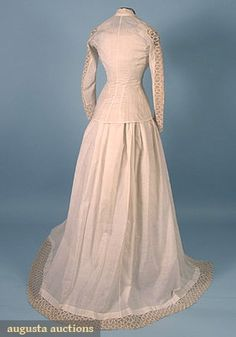 COTTON & LACE WEDDING GOWN, 1878-1880 4 pieces, c/o jacket, under-bodice, skirt & over-skirt, all decorated w/ rick-rack lace, including small cloth flower corsage.