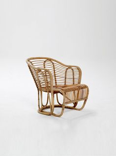 A Basket Chair, made of bamboo. Designed by Edward & Tove Kindt-Larsen. Produced by R Wengler, Copenhagen. Designed for the Danish Pavilion in New