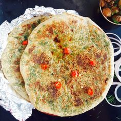 Tava Aloo Kulcha or Stuffed Leavened Indian Flatbread Cooked On A Griddle is delicious.
