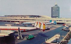 Two Lockheed Super Constellation airliners (Iberia, Sabena) at New York Idlewild Airport (IDL) in the late 1950s.
