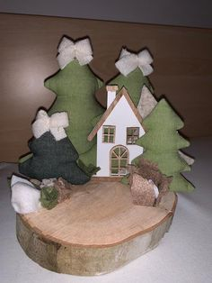 The wooden cottage with Christmas trees is built on a wooden stump. Wooden Cottage, Xmas, Christmas Tree, Hobby, Advent, Gingerbread, Christmas Decorations, Rose, Floral