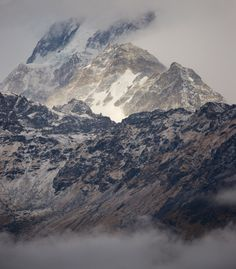 Subtle colours on Annapurna I shrouded in cloud by Tristan Brittaine on 500px