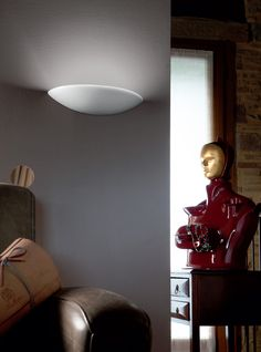 """Luna is a Wall lamp available in white glazed ceramic, coulored line, """"cotto"""" ceramic or cotto/white glazed ceramic."""